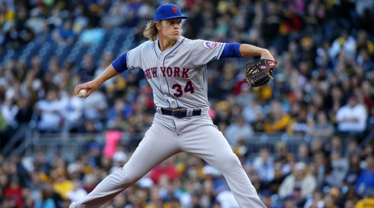New York Mets starting pitcher Noah Syndergaard (34) delivers during the first inning of a baseball game against the Pittsburgh Pirates in Pittsburgh, Friday, May 22, 2015. (AP Photo/Gene J. Puskar)