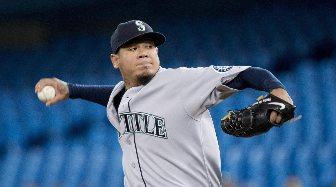 Seattle Mariners starting pitcher Felix Hernandez works against the Toronto Blue Jays during the first inning of a baseball game in Toronto on Friday, May 22, 2015. (Nathan Denette/The Canadian Press via AP)