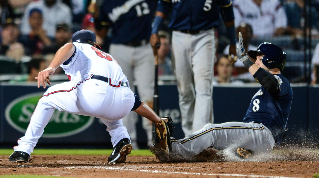 Milwaukee Brewers' Ryan Braun (8) is tagged out by Atlanta Braves relief pitcher Ian Thomas (60) after trying to steal home on a wild pitch in the sixth inning of a baseball game Friday, May 22, 2015, in Atlanta. (AP Photo/Jon Barash)