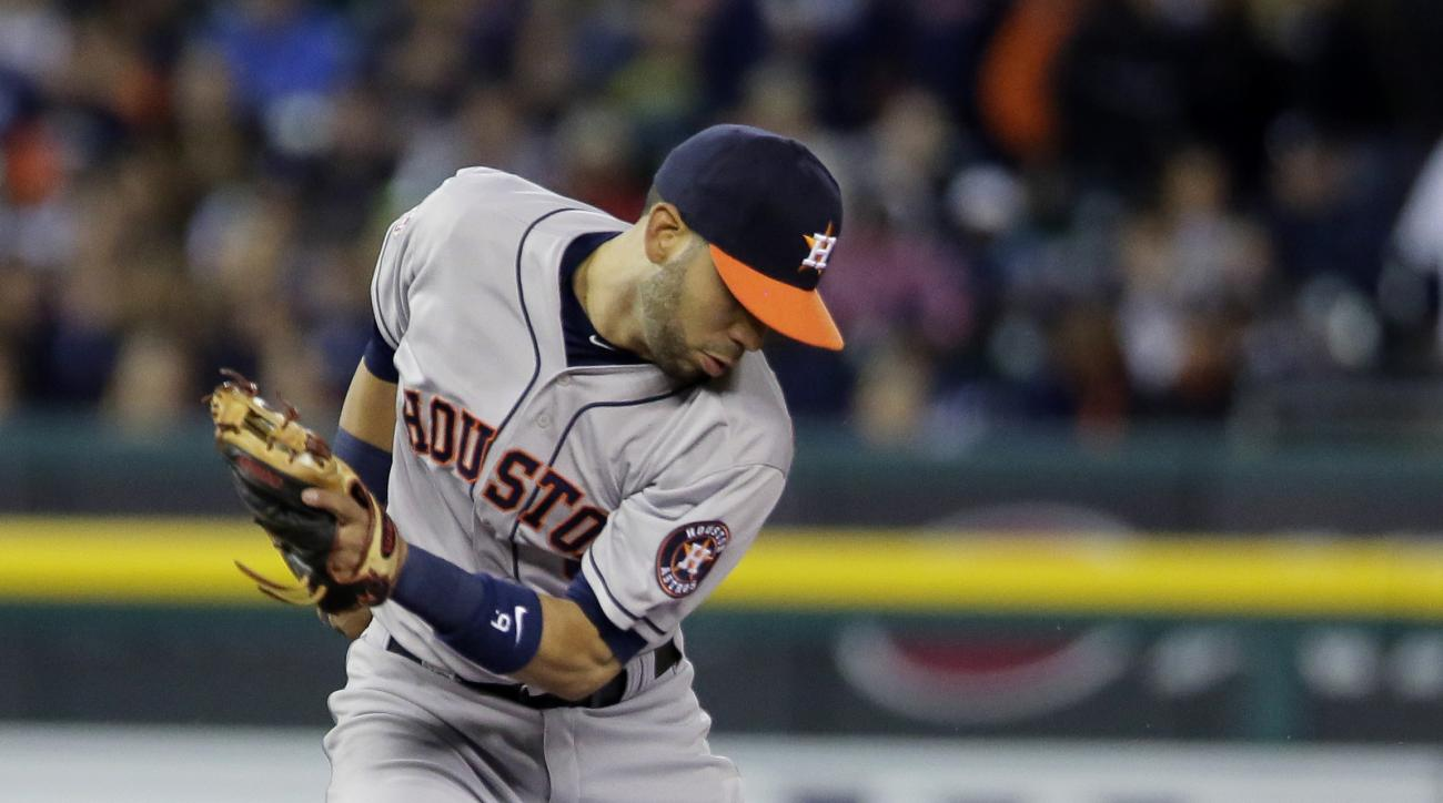 Detroit Tigers' Jose Iglesias (1) beats the throw to Houston Astros shortstop Marwin Gonzalez (9) to steal second base during the seventh inning of a baseball game Friday, May 22, 2015, in Detroit. (AP Photo/Duane Burleson)