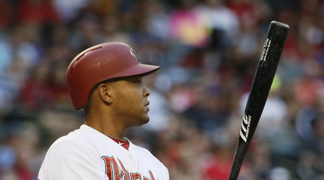 Arizona Diamondbacks' Yasmany Tomas prepares to hit against the Chicago Cubs during the first inning of a baseball game, Friday, May 22, 2015, in Phoenix. (AP Photo/Matt York)