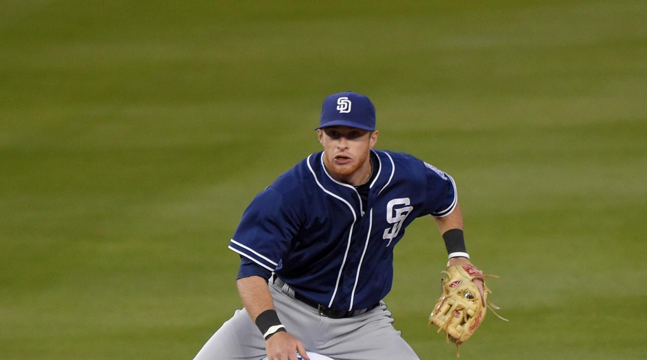 Los Angeles Dodgers' Yasmani Grandal, below, is forced out at second as San Diego Padres shortstop Clint Barmes throws out Justin Turner at first during the second inning of a baseball game, Friday, May 22, 2015, in Los Angeles. (AP Photo/Mark J. Terrill)