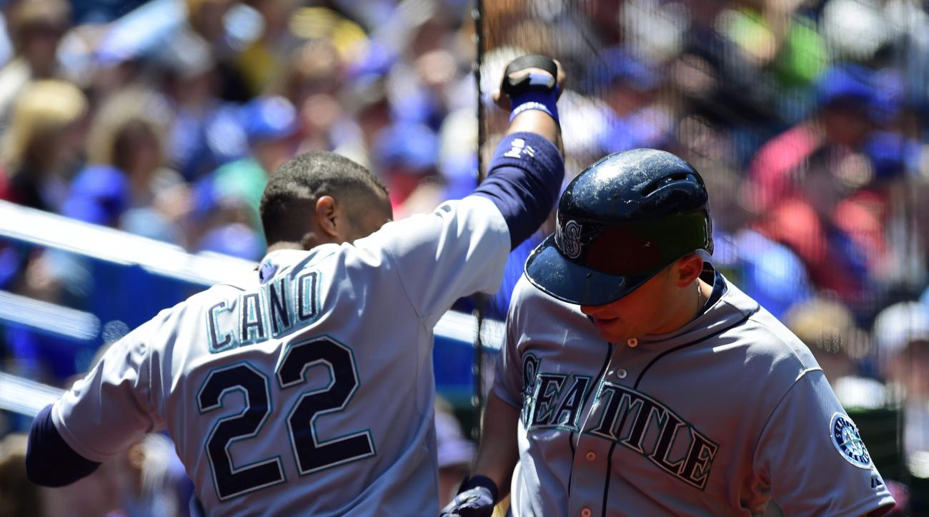 Seattle Mariners' Kyle Seager, right, celebrates a solo home run with teammate Robinson Cano during the second inning of a baseball game against the Toronto Blue Jays, Saturday, May 23, 2015, in Toronto. (Frank Gunn/The Canadian Press via AP) MANDATORY CR