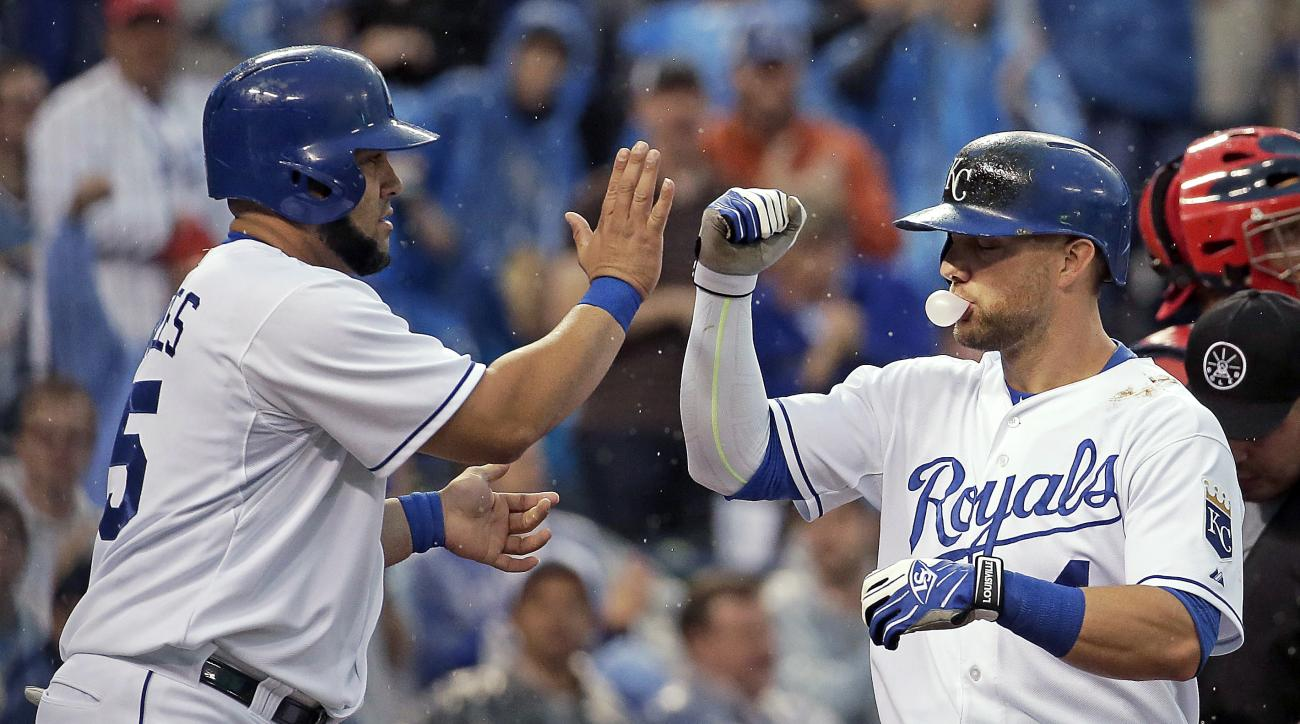 Kansas City Royals' Alex Gordon, right, celebrates with Kendrys Morales after Gordon hit a two-run home run during the second inning of a baseball game against the St. Louis Cardinals on Saturday, May 23, 2015, in Kansas City, Mo. (AP Photo/Charlie Riedel