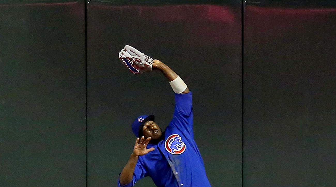 Chicago Cubs center fielder Dexter Fowler makes the leaping catch for the out on a ball hit by Arizona Diamondbacks' Paul Goldschmidt in the seventh inning during a baseball game, Saturday, May 23, 2015, in Phoenix. (AP Photo/Rick Scuteri)