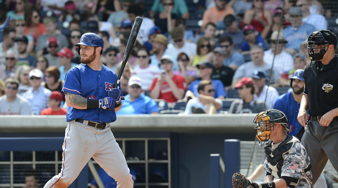 FILE - In this May 10, 2015 file photo, Texas Rangers' Josh Hamilton bats in the fifth inning against the Nashville Sounds on in Nashville, Tenn. Hamilton is done with his personal spring training and ready to rejoin the Texas Rangers. The slugger is set