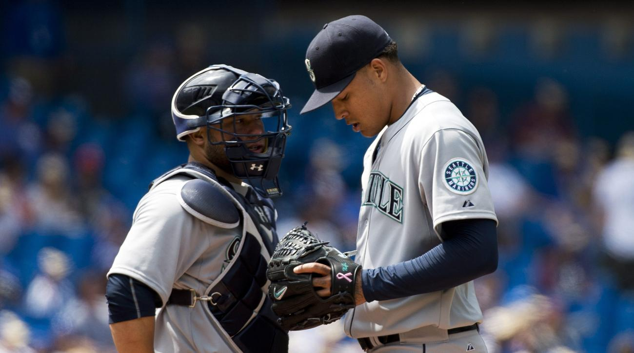 Seattle Mariners starting pitcher Taijuan Walker, right, talks with catcher Welington Castillo, left, after allowing four runs during fifth-inning baseball game action against the Toronto Blue Jays in Toronto, Sunday, May 24, 2015. (Nathan Denette/The Can