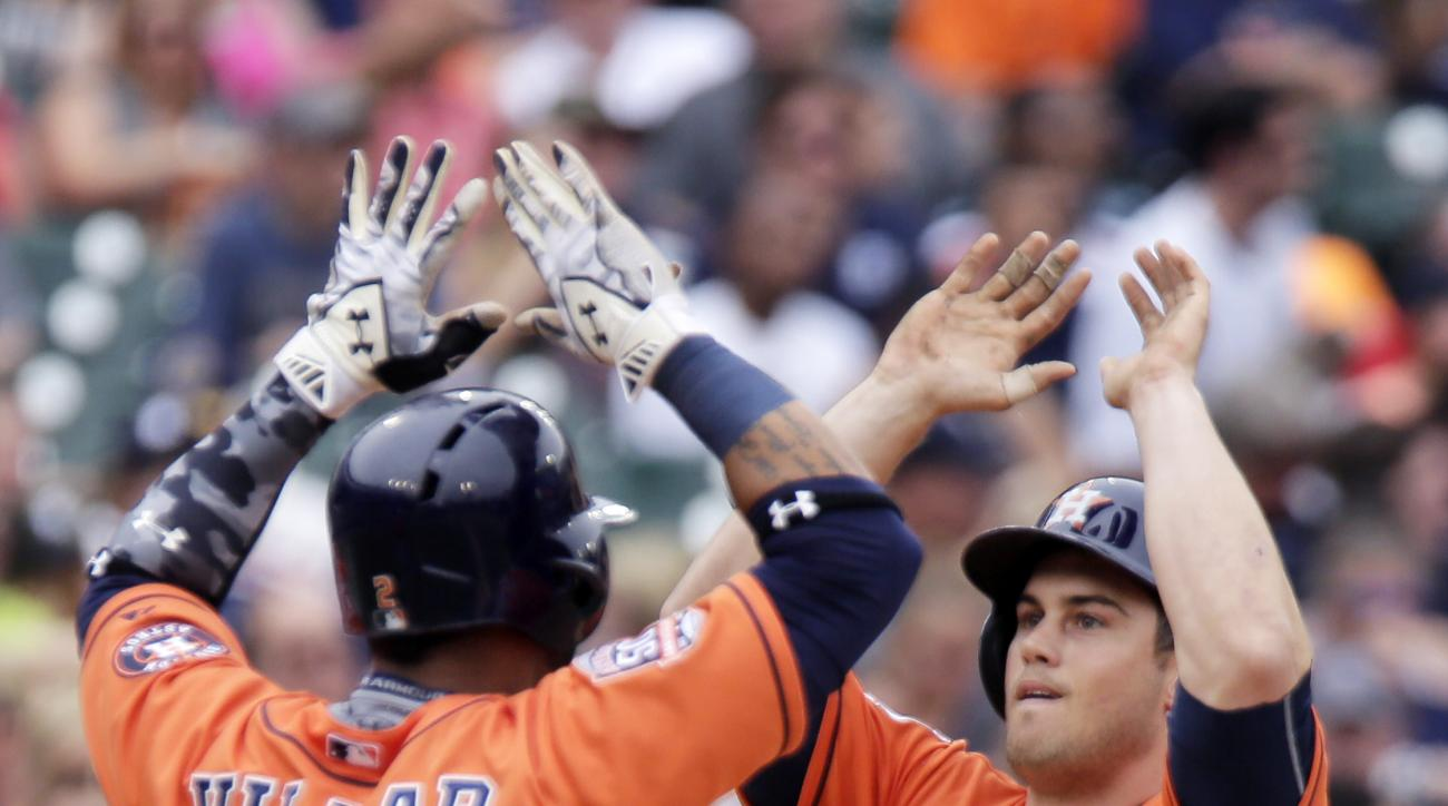 Houston Astros' Preston Tucker (20) celebrates his three-run home run against the Detroit Tigers with Jonathan Villar (2) during the sixth inning of a baseball game Sunday, May 24, 2015, in Detroit. (AP Photo/Duane Burleson)
