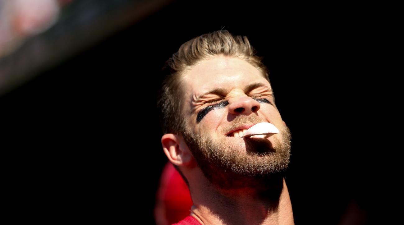 Washington Nationals' Bryce Harper laughs with a teammate in the dugout during a baseball game against the Philadelphia Phillies, Sunday, May 24, 2015, at Nationals Park in Washington. (AP Photo/Andrew Harnik)