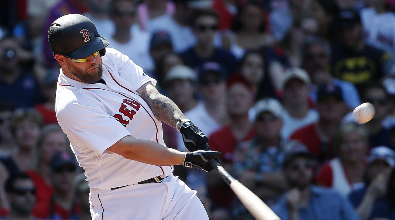 Boston Red Sox's Mike Napoli hits a two-run double during the eighth inning of a baseball game against the Los Angeles Angels, Sunday, May 24, 2015, in Boston. (AP Photo/Michael Dwyer)