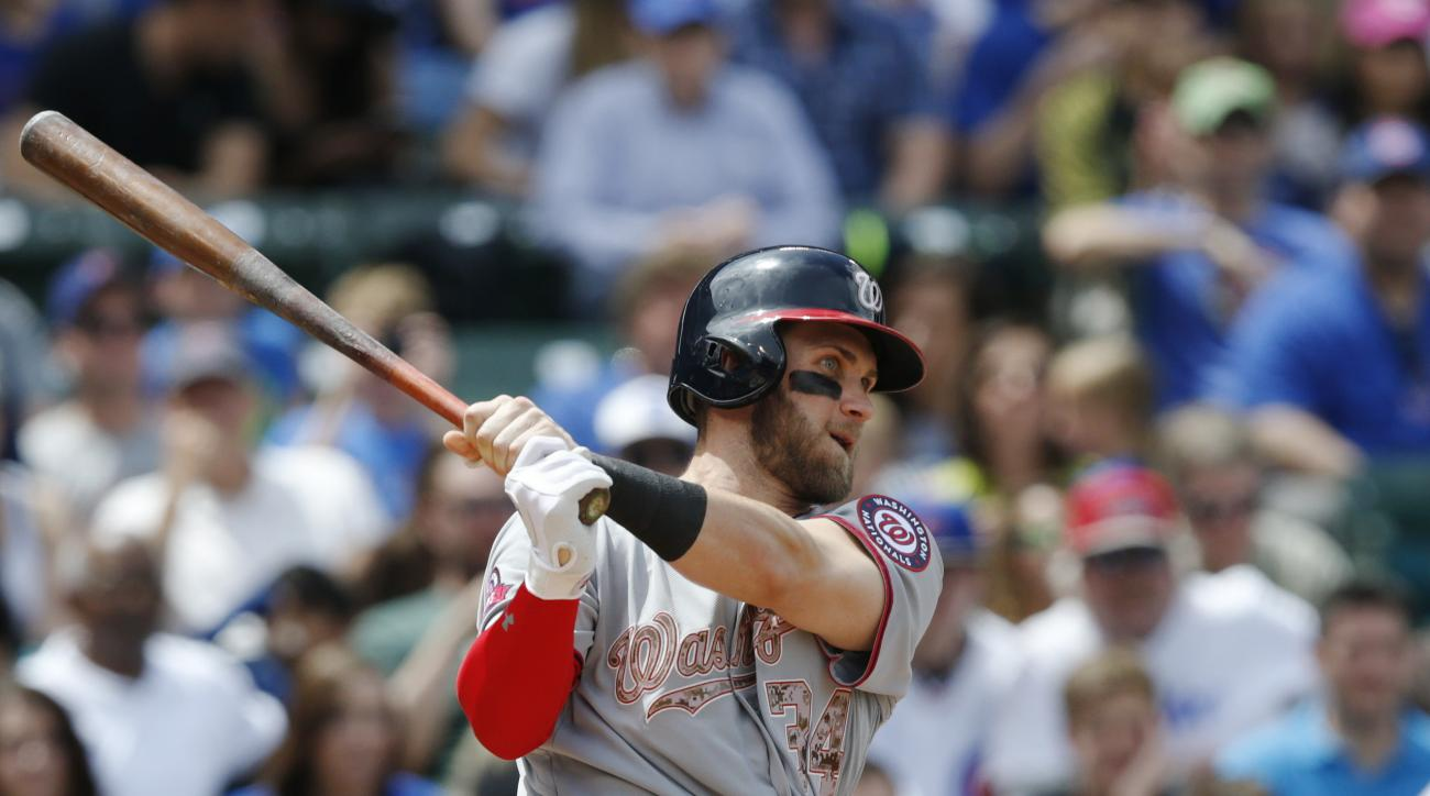 Washington Nationals' Bryce Harper (34) hits a double against the Chicago Cubs during the fourth inning of a baseball game Monday, May 25, 2015, in Chicago. (AP Photo/Andrew A. Nelles)