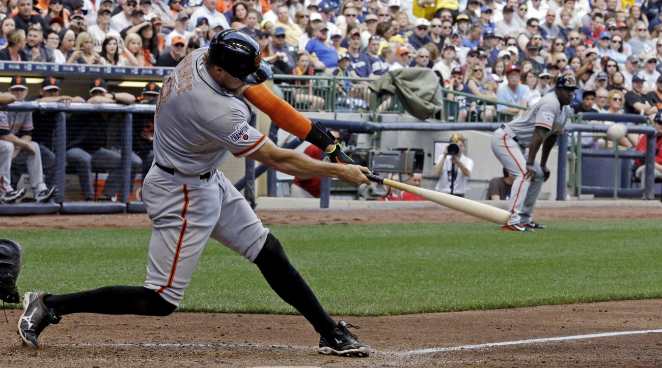 San Francisco Giants' Hunter Pence hits a two-run double during the sixth inning of a baseball game against the Milwaukee Brewers, Monday, May 25, 2015, in Milwaukee. (AP Photo/Morry Gash)