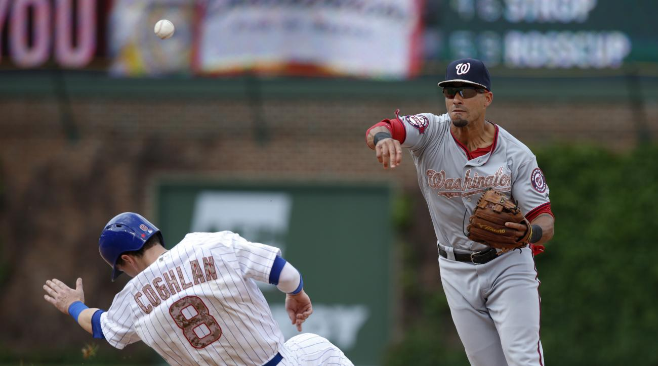 Washington Nationals shortstop Ian Desmond, right, forces out Chicago Cubs' Chris Coghlan on a double play hit by Mike Baxter during the seventh inning of a baseball game Monday, May 25, 2015, in Chicago. (AP Photo/Andrew A. Nelles)