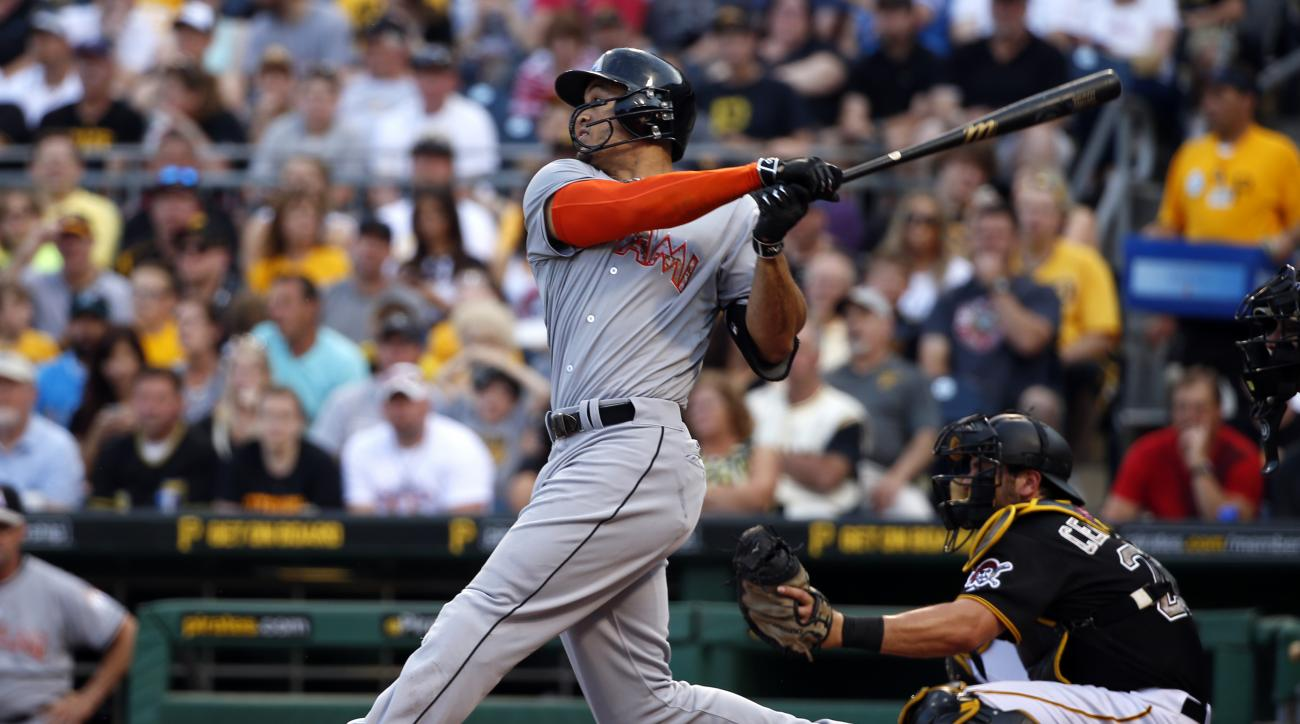 Miami Marlins' Giancarlo Stanton hits a solo-home run off Pittsburgh Pirates starting pitcher Charlie Morton in the third inning of a baseball game in Pittsburgh, Monday, May 25, 2015. (AP Photo/Gene J. Puskar)