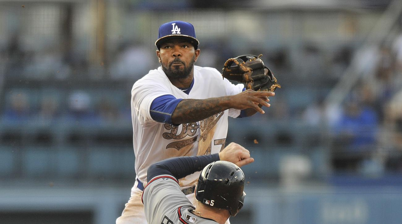 Atlanta Braves Freddie Freeman is forced out at second base as against the Los Angeles Dodgers second baseman Howie Kendrick throws to first to complete the double play during the fifth inning of a baseball game in Los Angeles, Monday, May 25, 2015. (AP P