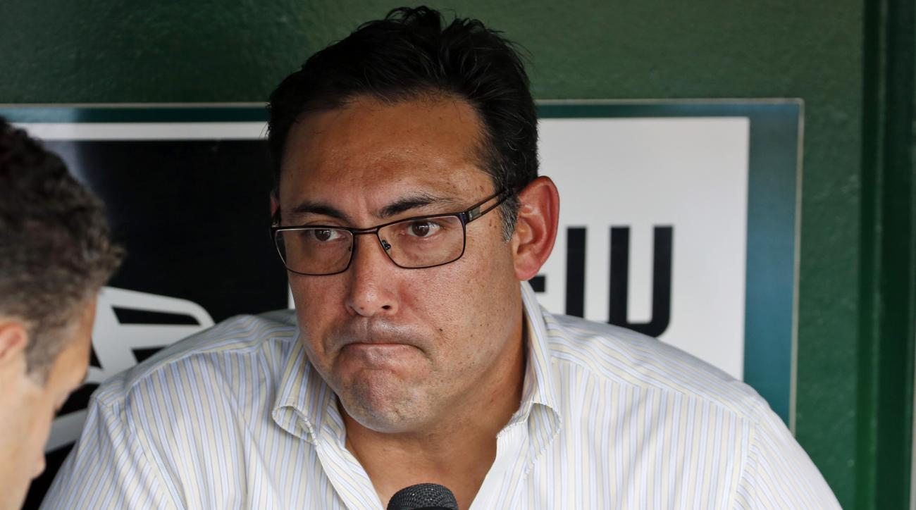 FILE - In this July 31, 2014, file photo, Philadelphia Phillies general manager Ruben Amaro Jr. pauses while speaking to reporters before the Phillies'baseball game against the Washington Nationals in Washington. Amaro has apologized to Phillies fans for