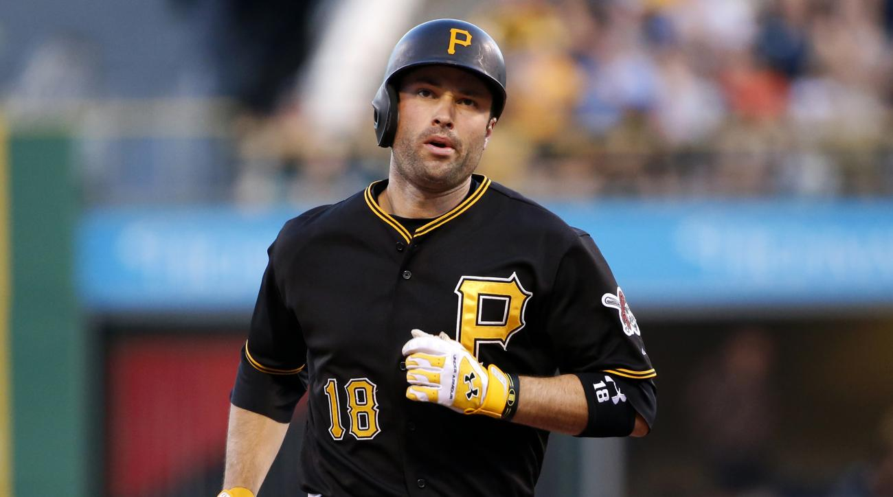 Pittsburgh Pirates' Neil Walker rounds second after hitting a two-run home run off Miami Marlins starting pitcher Jose Urena during the second inning of a baseball game in Pittsburgh, Tuesday, May 26, 2015. (AP Photo/Gene J. Puskar)