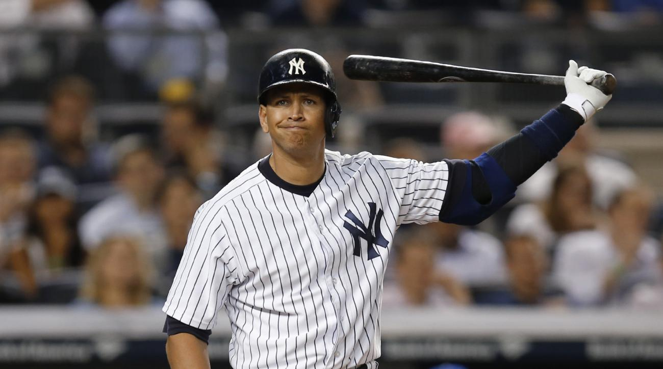 New York Yankees designated hitter Alex Rodriguez reacts during a seventh-inning at-bat in a baseball game against the Kansas City Royals at Yankee Stadium in New York, Tuesday, May 26, 2015. Rodriguez flew out to left field. (AP Photo/Kathy Willens)