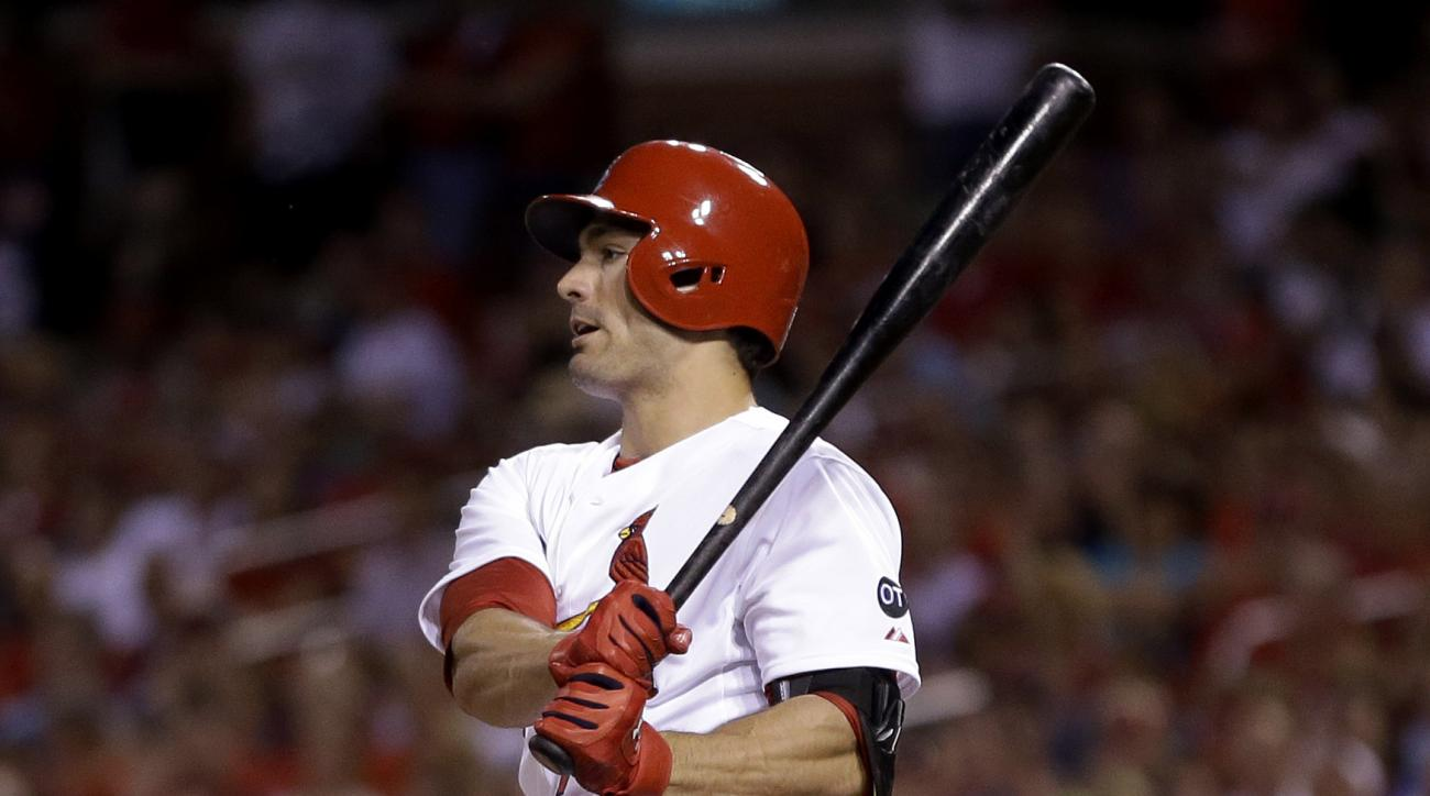 St. Louis Cardinals' Randal Grichuk follows through on an RBI single during the fourth inning of a baseball game against the Arizona Diamondbacks on Tuesday, May 26, 2015, in St. Louis. (AP Photo/Jeff Roberson)