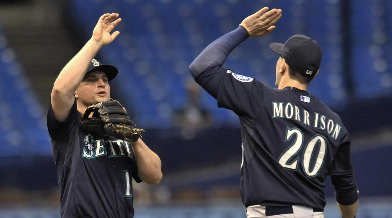 Seattle Mariners' Kyle Seager, left, and Logan Morrison (20) celebrate the team's 7-6 win over the Tampa Bay Rays in 10 innings in a baseball game Tuesday, May 26, 2015, in St. Petersburg, Fla. Seager had three hits, including two home runs, and drove in