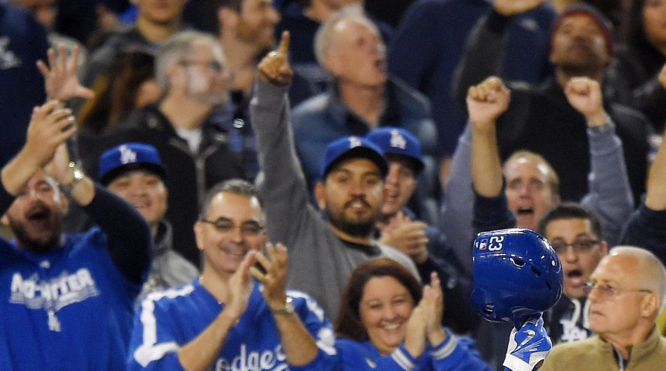 Los Angeles Dodgers' Adrian Gonzalez acknowledges fans after hitting a two-run home run during the fifth inning of a baseball game against the Atlanta Braves, Tuesday, May 26, 2015, in Los Angeles. (AP Photo/Mark J. Terrill)
