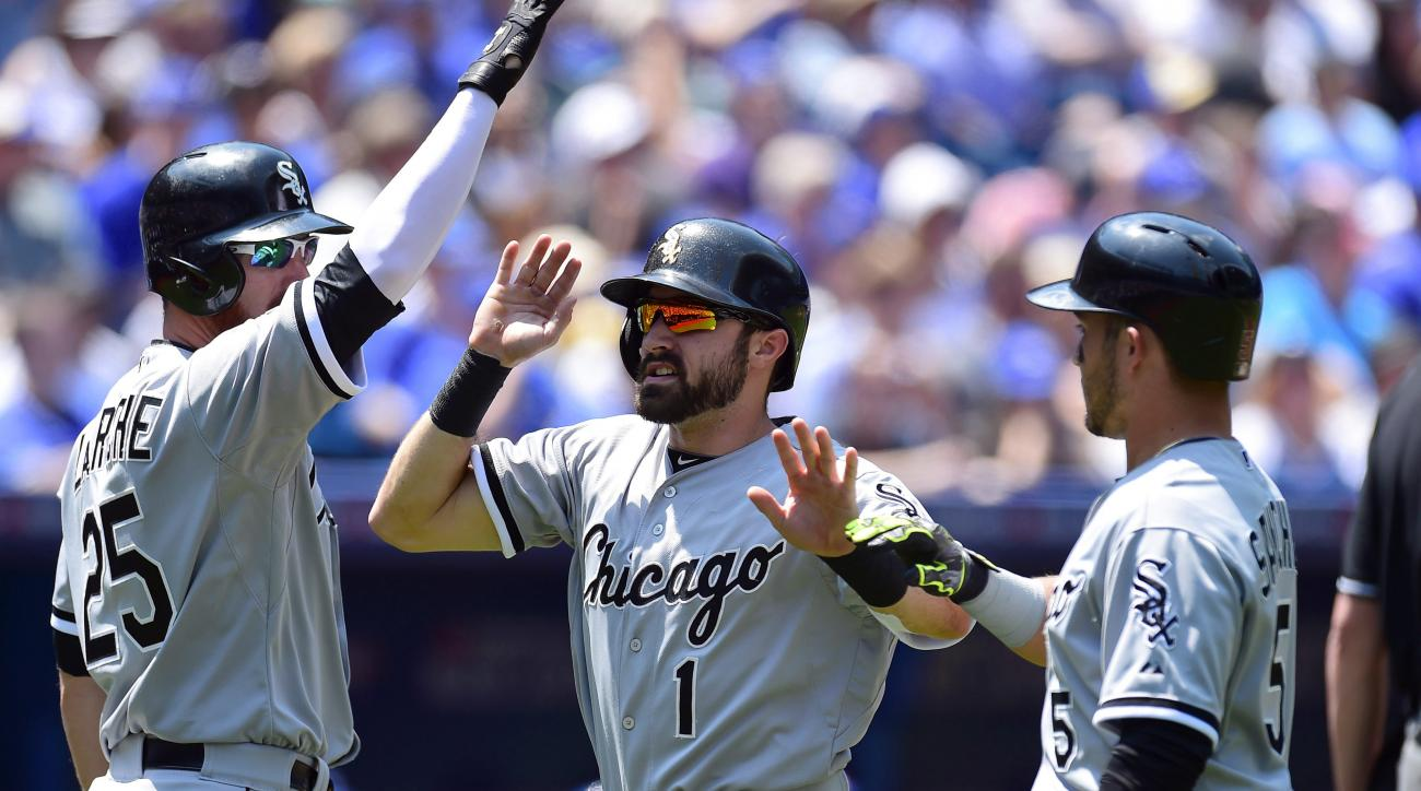Chicago White Sox Adam Eaton (1) and Carlos Sanchez (5) celebrate with teammate Adam LaRoche (25) after scoring in the third inning of a baseball game against the Toronto Blue Jays in Toronto, Wednesday, May 27, 2015.(Frank Gunn/The Canadian Press via AP)