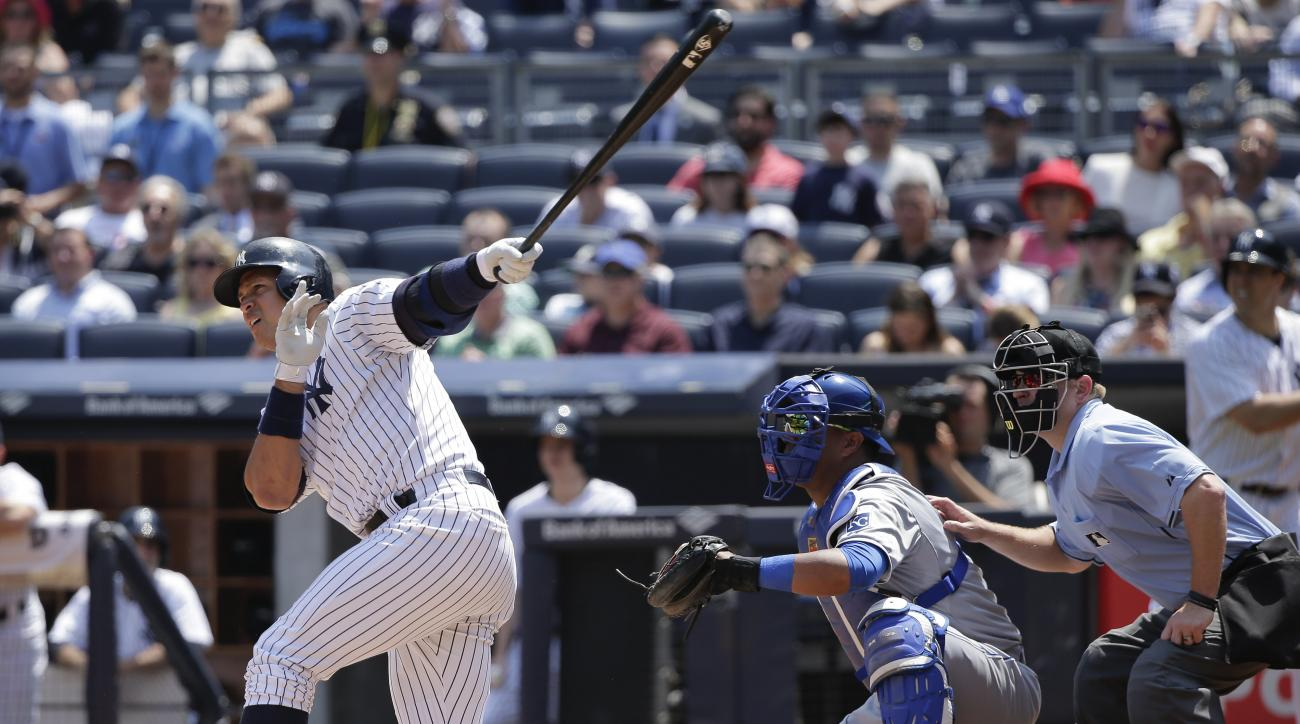 New York Yankees designated hitter Alex Rodriguez (13) follows through on a three-run home run to left field against the Kansas City Royals during the third inning of a baseball game, Wednesday, May 27, 2015, in New York. (AP Photo/Julie Jacobson)