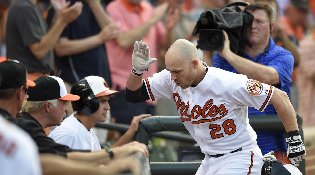 Baltimore Orioles' Steve Pearce (28) reacts with the dugout as he celebrates his home run during the fourth inning of a baseball game against the Houston Astros, Wednesday, May 27, 2015, in Baltimore. (AP Photo/Nick Wass)