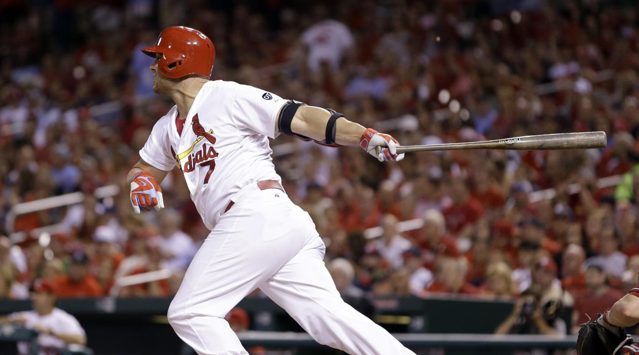 St. Louis Cardinals' Matt Holliday follows through on a single during the fifth inning of a baseball game against the Arizona Diamondbacks Wednesday, May 27, 2015, in St. Louis. With the single, Holliday has reached base in 43 straight games to start the