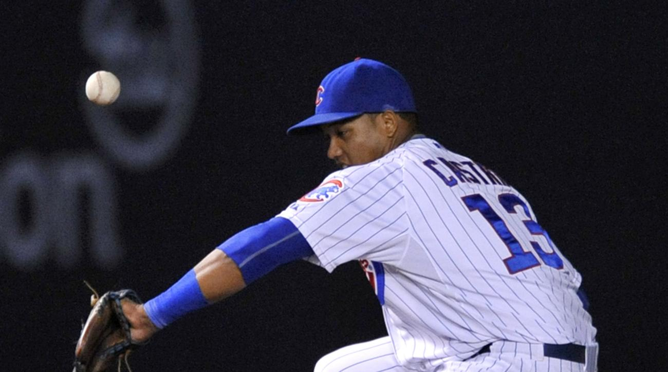 Chicago Cubs shortstop Starlin Castro commits an error on a grounder hit by Washington Nationals' Dan Uggla during the sixth inning of a baseball game in Chicago, Wednesday, May 27, 2015. Uggla was safe at first. (AP Photo/Paul Beaty)