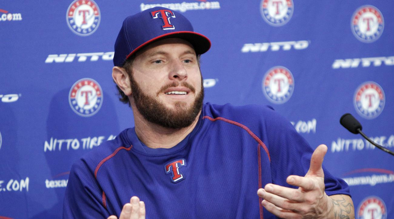 Texas Rangers outfielder Josh Hamilton answers questions during a news conference, Thursday, May 28, 2015, in Arlington, Texas. Hamilton will play his first home game with the Rangers since being reacquired from the Los Angeles Angels. (AP Photo/Brandon W