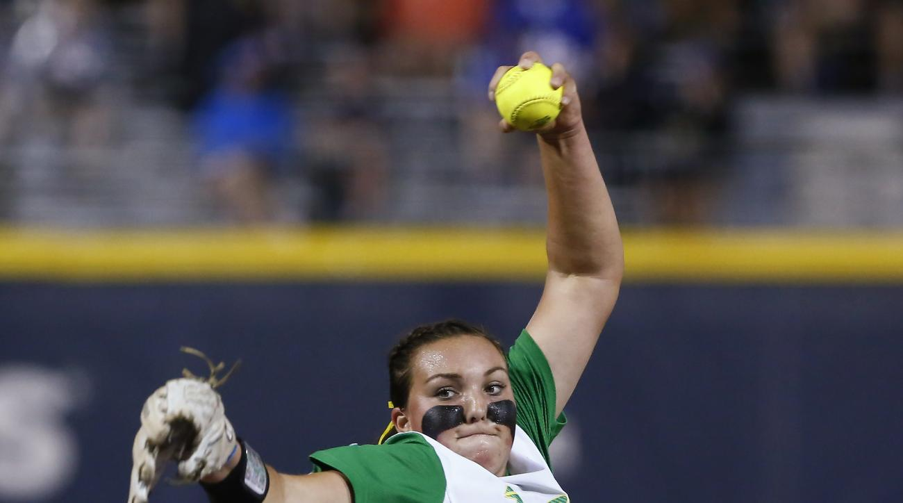 Oregon's Sheridan Hawkins pitches in the first inning against UCLA in an NCAA Women's College World Series softball game in Oklahoma City, Thursday, May 28, 2015. (AP Photo/Alonzo Adams)