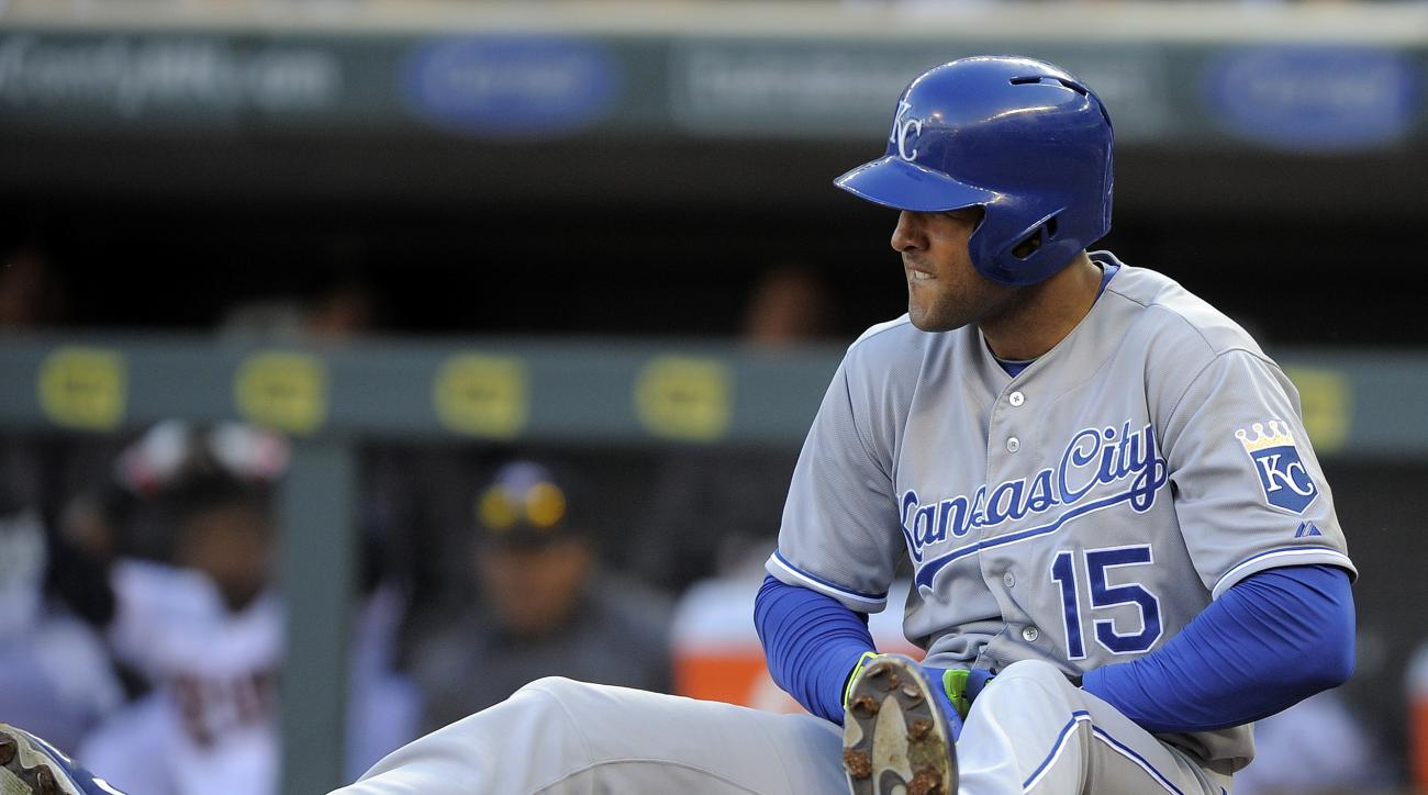Kansas City Royals' Alex Rios looks out at Minnesota Twins pitcher J.R. Graham after being hit on the wrist during the eighth inning of a baseball game, Monday, April 13, 2015 in Minneapolis. The Royals won 12-3. (AP Photo/Tom Olmscheid)