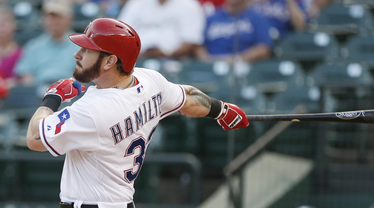 Texas Rangers Josh Hamilton watches his hit fly over the right field wall for a solo home-run during the second inning of a baseball game against the Boston Red Sox, Friday, May 29, 2015, in Arlington, Texas. (AP Photo/Brandon Wade)