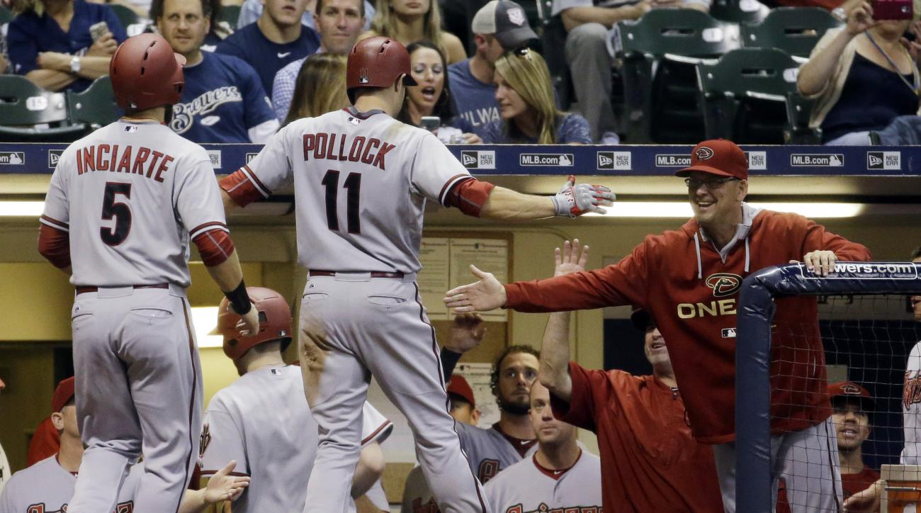 Arizona Diamondbacks' A.J. Pollock is congratulated after hitting a two-run home run during the ninth inning of a baseball game against the Milwaukee Brewers on Friday, May 29, 2015, in Milwaukee. (AP Photo/Morry Gash)