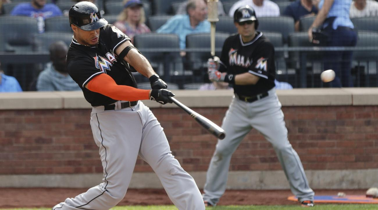 Miami Marlins' Giancarlo Stanton hits a home run during the third inning of a baseball game against the New York Mets, Saturday, May 30, 2015, in New York. (AP Photo/Frank Franklin II)