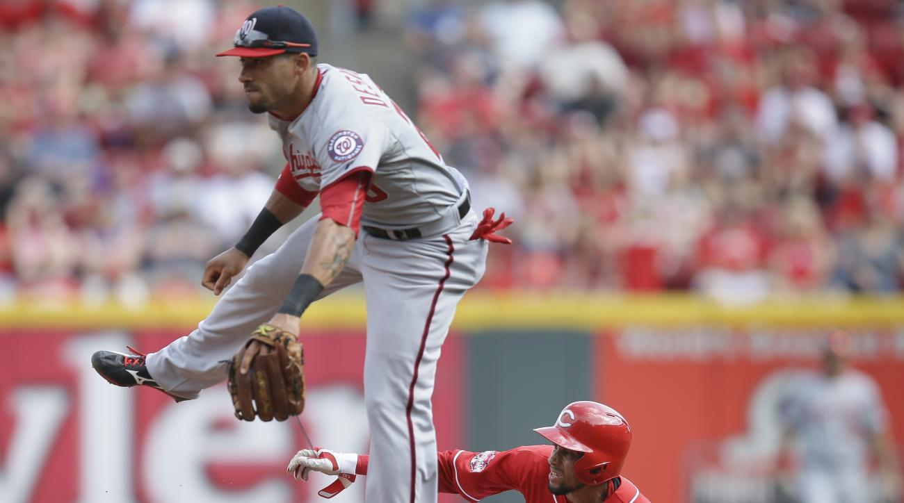 Cincinnati Reds' Billy Hamilton (6) steals second base against Washington Nationals shortstop Ian Desmond in the third inning of a baseball game, Saturday, May 30, 2015, in Cincinnati. (AP Photo/John Minchillo)