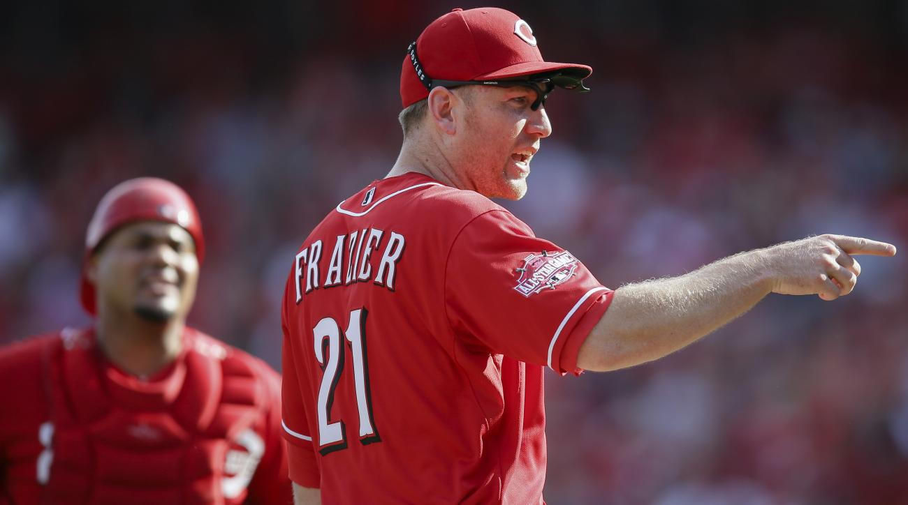 Cincinnati Reds third baseman Todd Frazier (21) has words with the Washington Nationals dugout after Nationals' Gio Gonzalez was hit by a pitched in the sixth inning of a baseball game, Saturday, May 30, 2015, in Cincinnati. (AP Photo/John Minchillo)