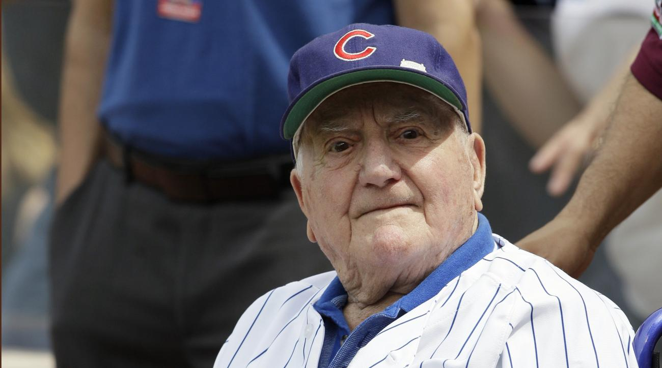 FILE - In this June 7, 2014, file photo, former Chicago Cubs shortstop Lennie Merullo looks toward the field before throwing out a ceremonial first pitch before a baseball game between the Miami Marlins and the Cubs in Chicago. Merullo, the oldest former