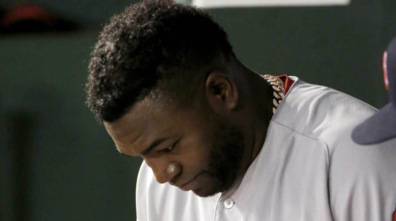 Boston Red Sox designated hitter David Ortiz looks on from the dugout during the eighth inning of a baseball game against the Texas Rangers, Saturday, May 30, 2015, in Arlington, Texas. Texas won 8-0. (AP Photo/Brandon Wade)