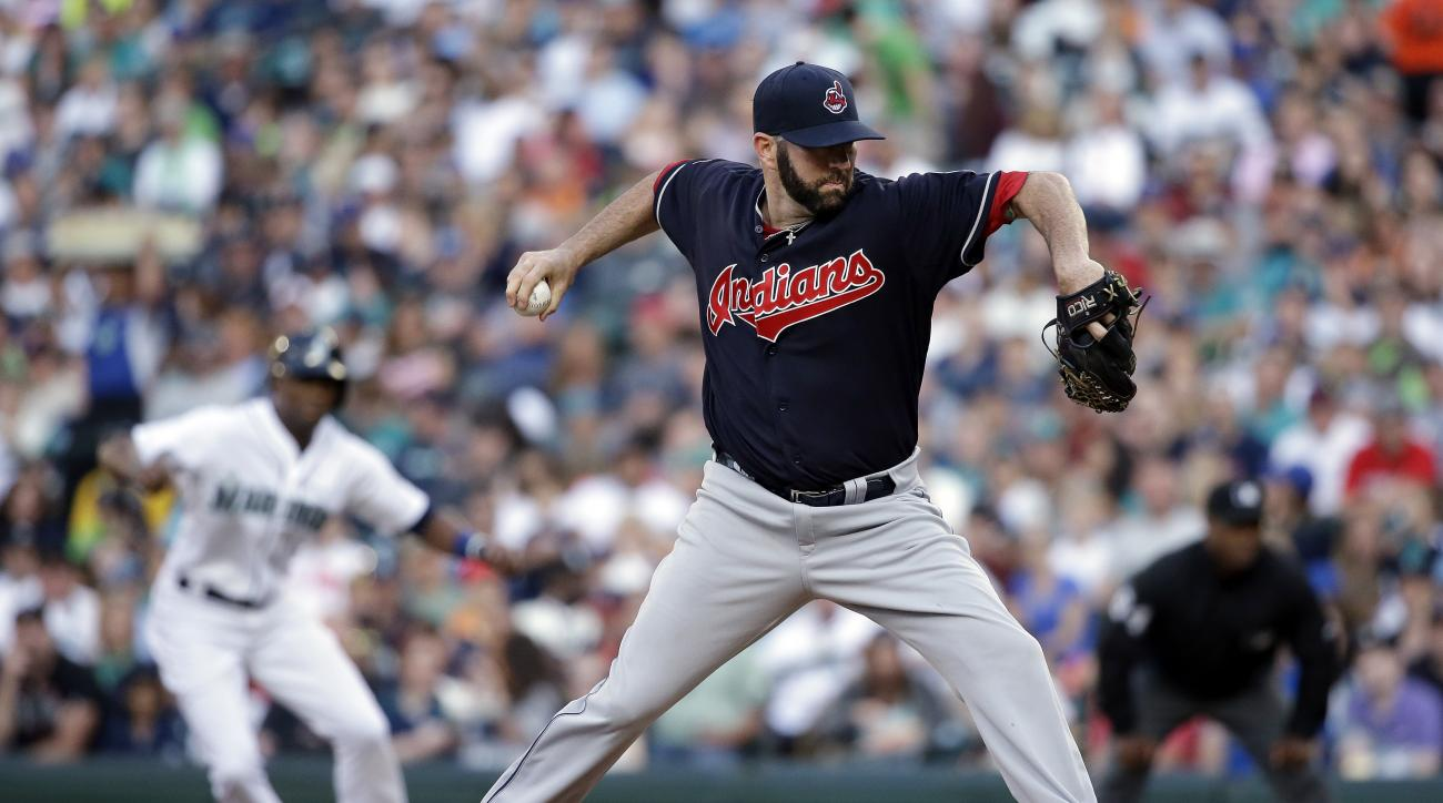 Cleveland Indians starting pitcher Shaun Marcum throws as Seattle Mariners' Austin Jackson leads off of first base behind in the first inning of a baseball game Saturday, May 30, 2015, in Seattle. (AP Photo/Elaine Thompson)