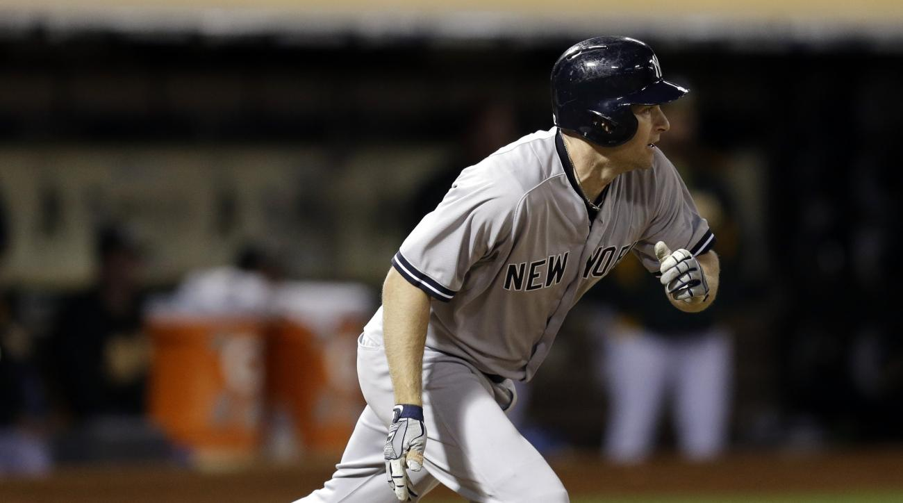 New York Yankees' Chase Headley drops his bat after hitting an RBI single against the Oakland Athletics in the fifth inning of a baseball game Saturday, May 30, 2015, in Oakland, Calif. (AP Photo/Ben Margot)