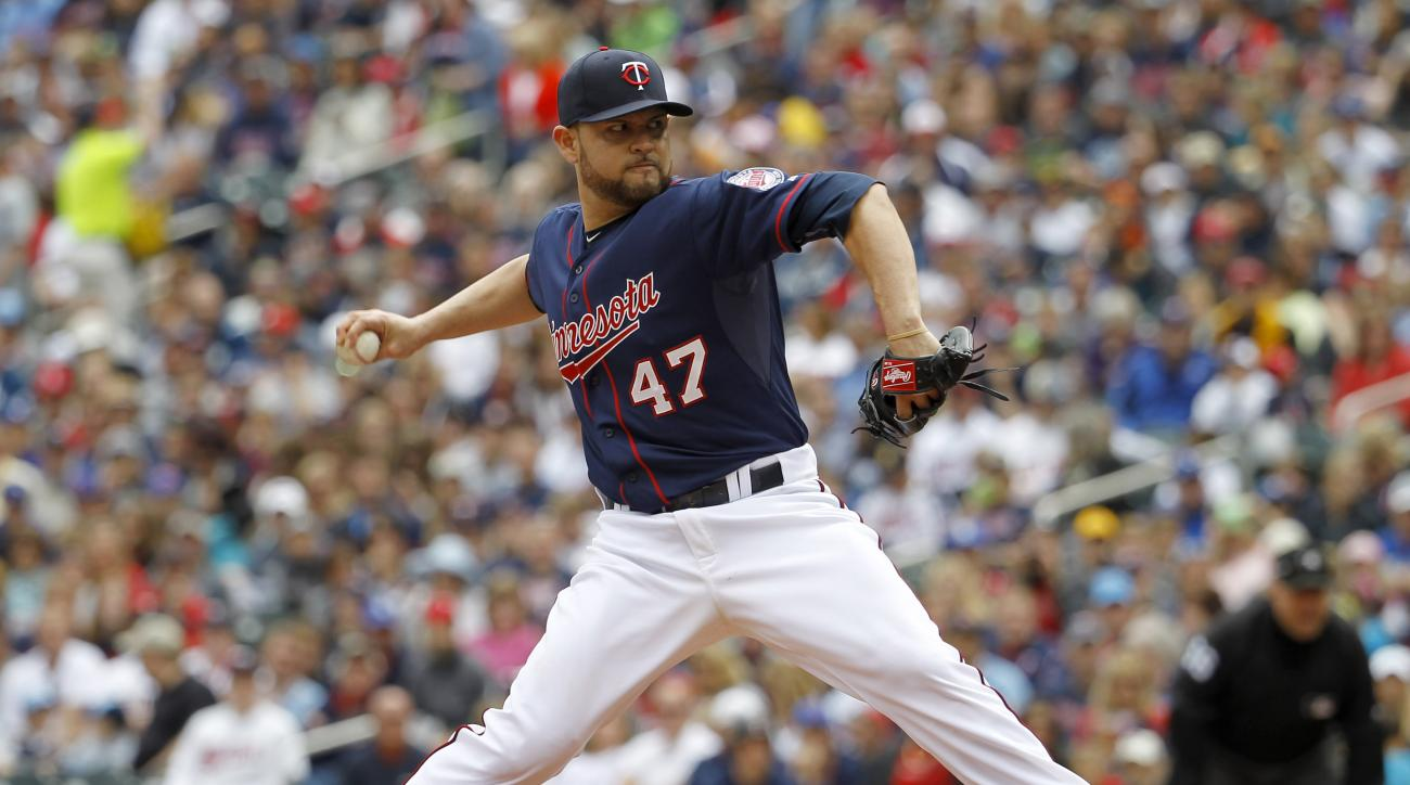 Minnesota Twins starting pitcher Ricky Nolasco delivers to the Toronto Blue Jays during the first inning of a baseball game in Minneapolis, Sunday, May 31, 2015. (AP Photo/Ann Heisenfelt)