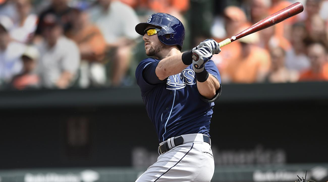Tampa Bay Rays' Steven Souza Jr. follows through on a three-run home run against the Baltimore Orioles in the fifth inning of a baseball game Sunday, May 31, 2015, in Baltimore. (AP Photo/Gail Burton)