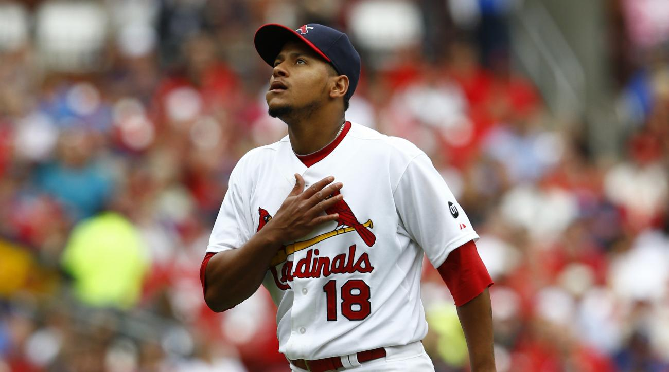 St. Louis Cardinals starting pitcher Carlos Martinez reacts after striking out Los Angeles Dodgers' Alex Guerrero during the seventh inning of a baseball game Sunday, May 31, 2015, in St. Louis. (AP Photo/Billy Hurst)