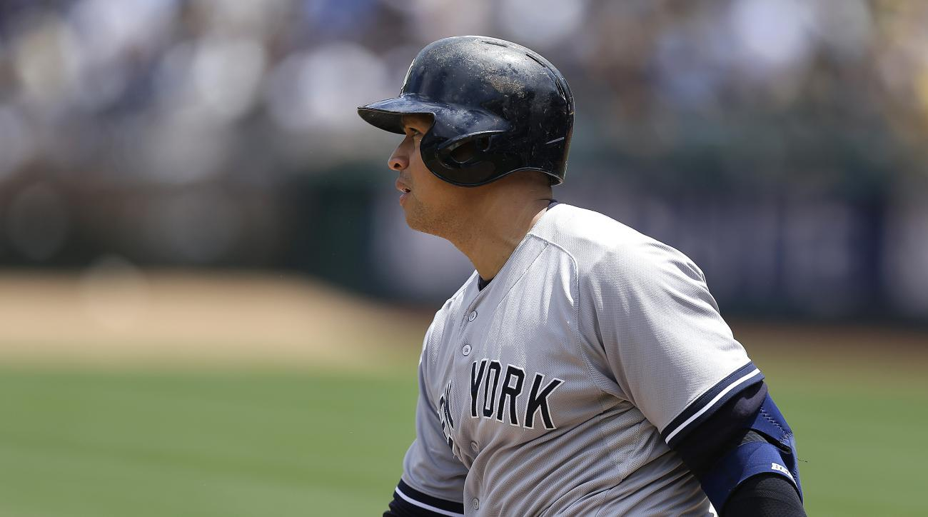 New York Yankees' Alex Rodriguez swings for a single off Oakland Athletics' Jesse Chavez in the first inning of a baseball game Sunday, May 31, 2015, in Oakland, Calif. (AP Photo/Ben Margot)