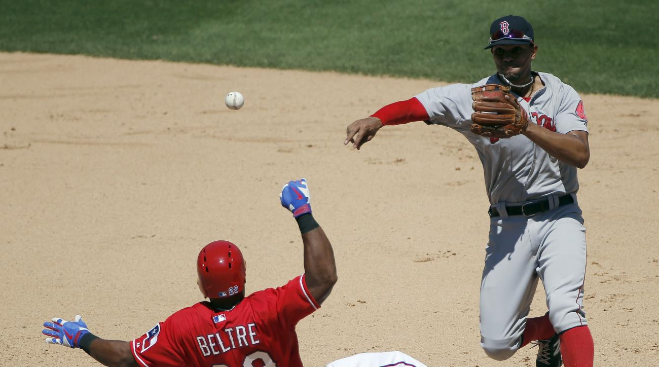 Texas Rangers' Adrian Beltre (29) slides into second as Boston Red Sox shortstop Xander Bogaerts throws to first during the fifth inning of a baseball game, Sunday, May 31, 2015, in Arlington, Texas. Beltre injured his left thumb on the play. (AP Photo/Br