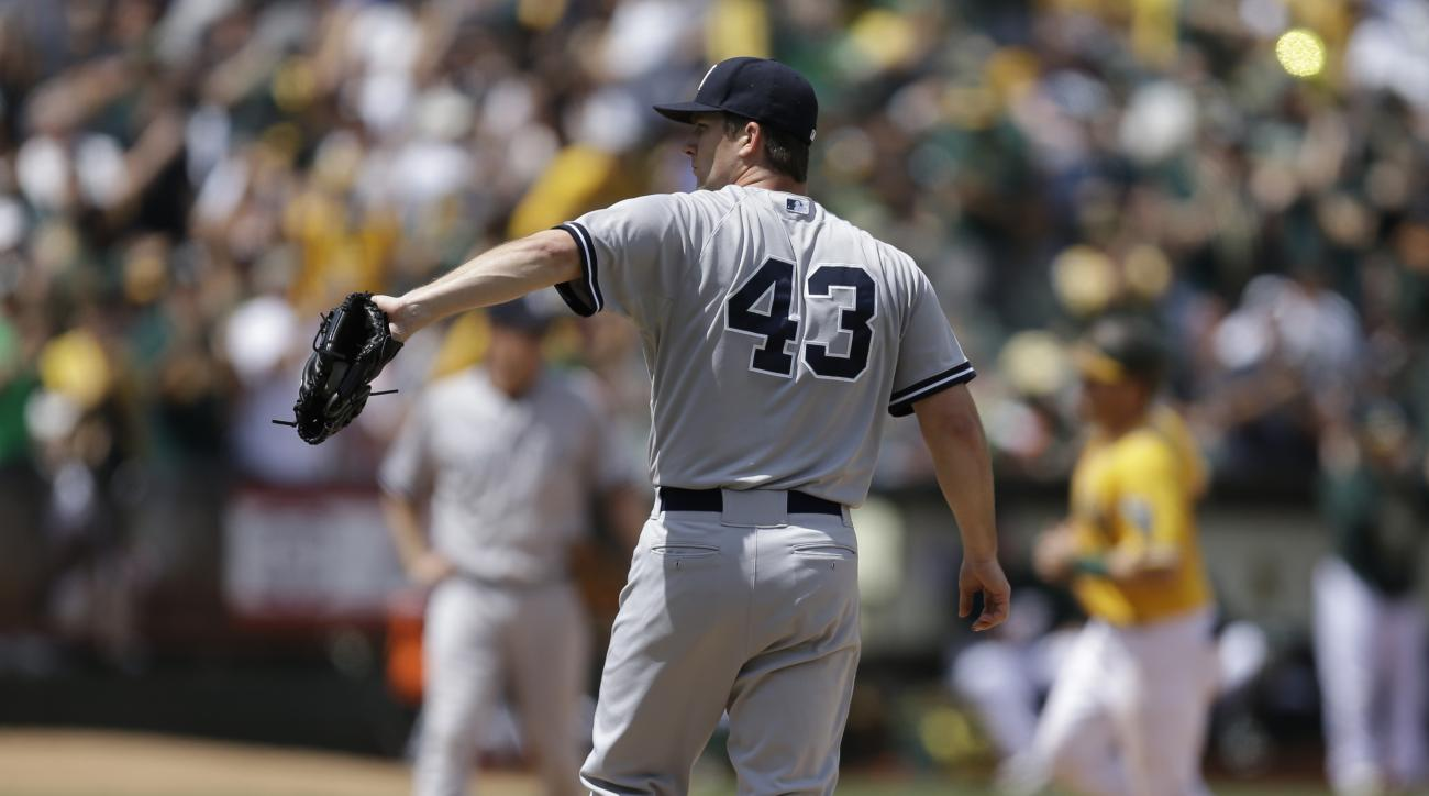New York Yankees' Adam Warren (43) waits for a new ball as Oakland Athletics' Stephen Vogt, right, runs the bases after hitting a two-run home run in the sixth inning of a baseball game, Sunday, May 31, 2015, in Oakland, Calif. (AP Photo/Ben Margot)