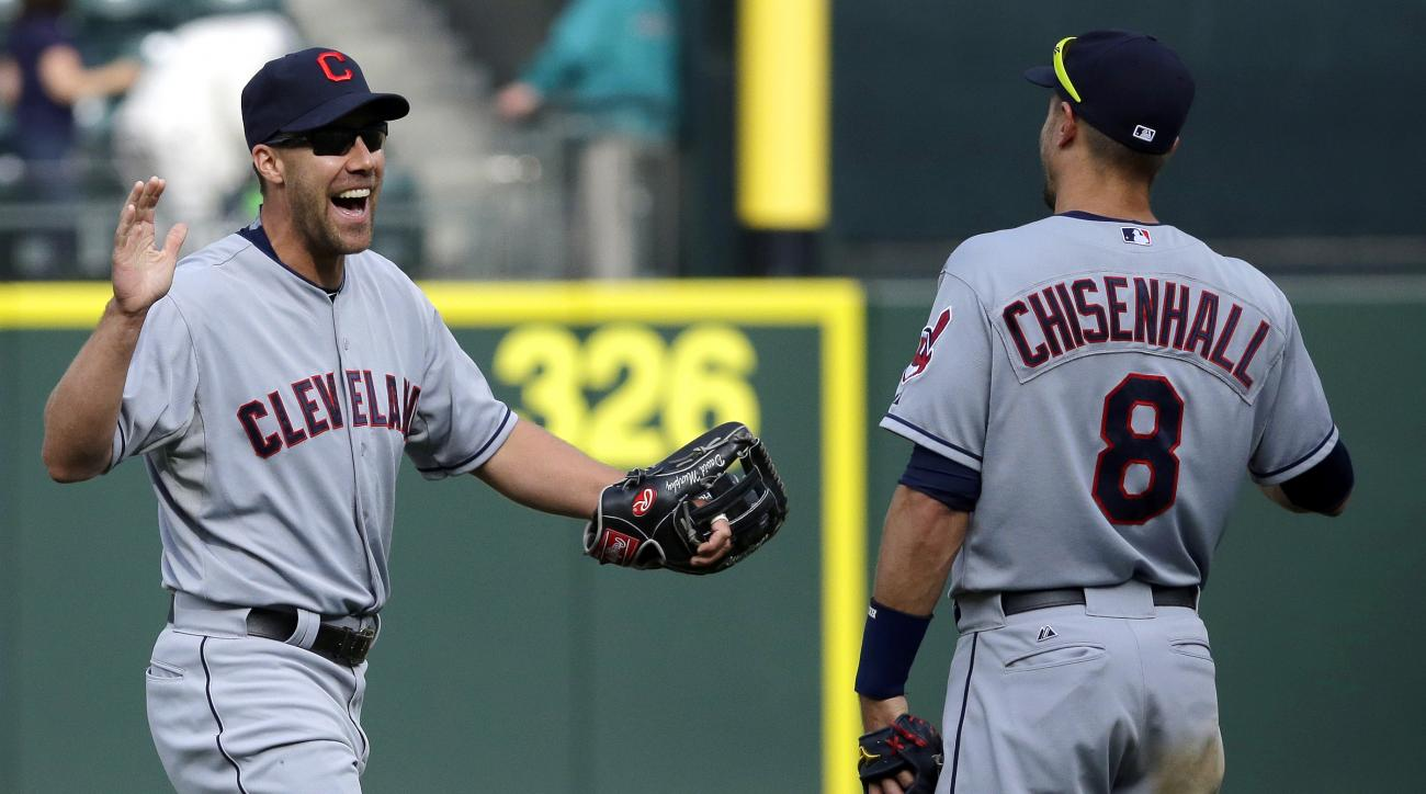 Cleveland Indians' David Murphy, left, greets teammate Lonnie Chisenhall after the Indians defeated the Mariners 6-3 in 12 innings in a baseball game, Sunday, May 31, 2015, in Seattle. (AP Photo/Ted S. Warren)