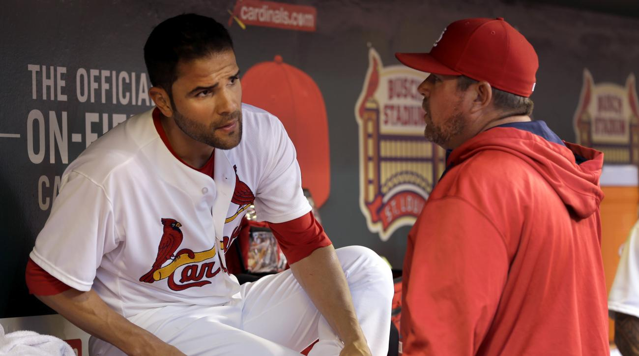 St. Louis Cardinals starting pitcher Jaime Garcia, left, talks with pitching coach Derek Lilliquist during the second inning of a baseball game against the Milwaukee Brewers Monday, June 1, 2015, in St. Louis. (AP Photo/Jeff Roberson)